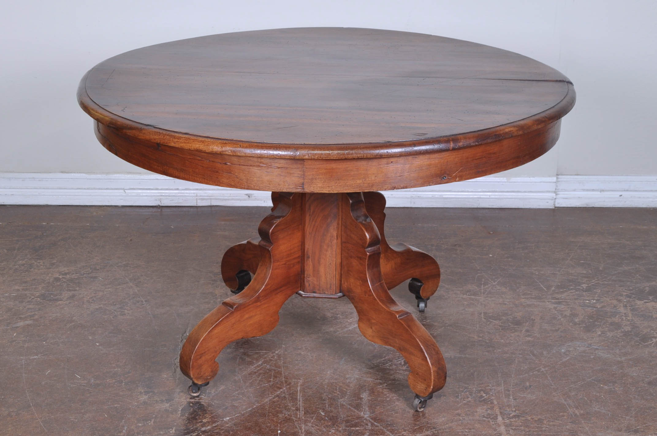Antique French Round Wooden Table On Pedestal Base With Original Caster Feet